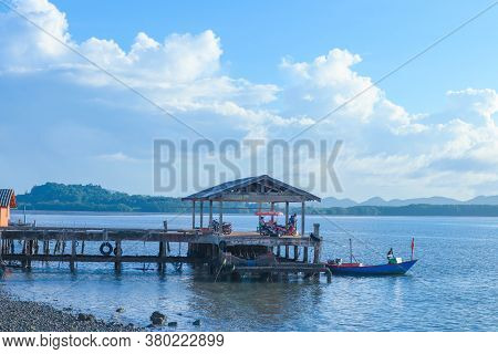 Wooden Hut In The Sea, The Mountains And Blue Sky.