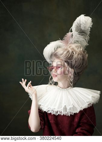 Trendy Eyewear, Youth. Young Woman As Marie Antoinette Isolated On Dark Green Background. Retro Styl