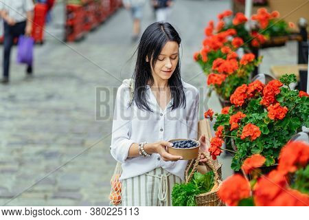 Beautiful Slim Brunette Woman With Straw Bag Full Of Fruits, Vegetables And Berries, Walking After S