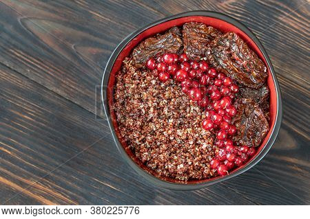 Bowl Of Red Quinoa With Nuts And Sun-dried Tomatoes