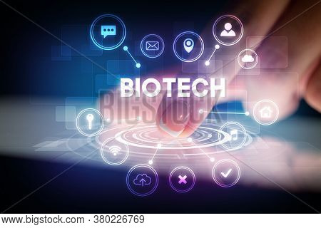 Finger touching tablet with web technology icons and BIOTECH inscription, web technology concept