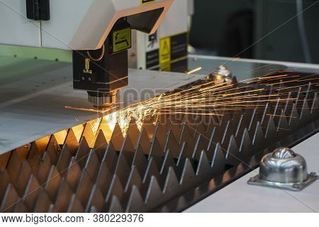 The Fiber Laser Cutting Machine Cutting  Machine Cut The Metal Plate. The Hi-technology Sheet Metal