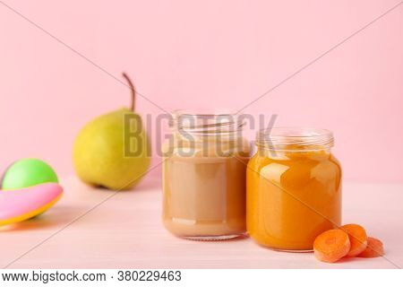 Glass Jars With Nutrient Baby Food On Pink Background. Vegetable And Fruit Puree