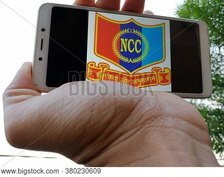 District Katni, India - May 23, 2020: Man Holding Smart Phone With Displayed National Cadet Corps Nc