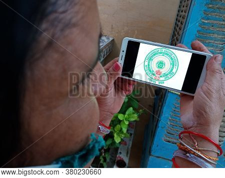 District Katni, India - May 23, 2020: Woman Holding Smart Phone With Displayed Government Of Andhra