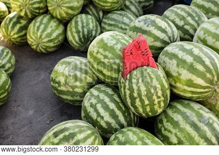 Many Big Sweet Green Watermelons And One Cut Watermelon. Young Green Watermelons. Watermelons Patter