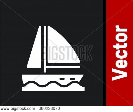 White Yacht Sailboat Or Sailing Ship Icon Isolated On Black Background. Sail Boat Marine Cruise Trav