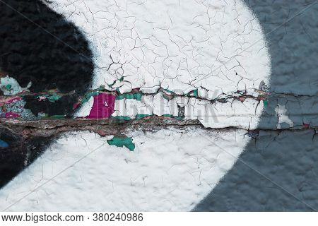 The Texture Of Cracked Paint In Several Multi-colored Layers Was Shot Close-up