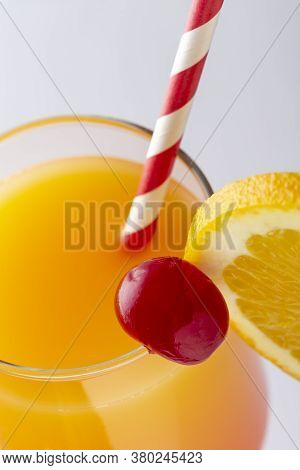 Detail Of Cold Tequila Sunrise Cocktail With Tequila, Pomegranate Juice And Orange Juice Decorated W