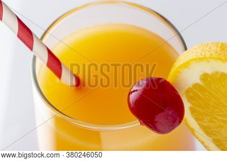 High Angle View Of Cold Tequila Sunrise Cocktail With Tequila, Pomegranate Juice And Orange Juice De