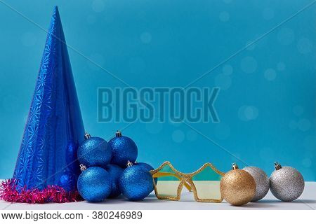 Set Of Christmas Decoration. Balls Festive Cap Golden Glasses And Red Tinsel. Copy Space. Xmas Conce