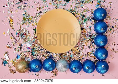 Happy New Year. Christmas Decoration. Winter Holidays. Plate And Xmas Toys On Pink Backdrop With Con