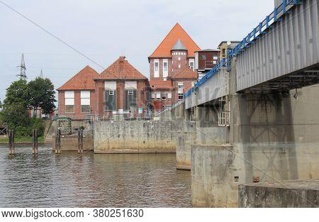 Dorverden, Germany, 19 July 2020: The Weir On The Weser River 'weserwehr', And Statkraft Power Stati