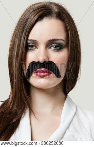 Portrait of Woman wearing fake moustache