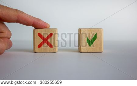 Hand Making A Choice Between Two Cubes With Yes And No On Neutral Background. Concept Of Choice. Bea
