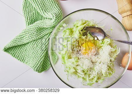 Ingredients For Cooking Zucchini Pancakes Or Fritters - Grated Zucchini, Egg, Flour. Top View