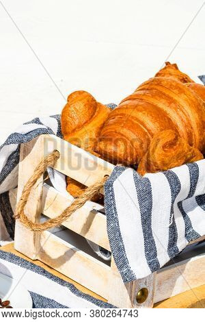 Fresh Croissant, Puff Pastry And Buttered French Croissant On Wooden Crate. Food And Breakfast Conce