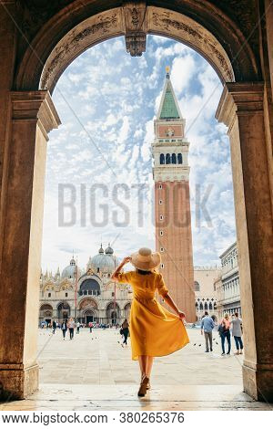 Woman Standing Looking At Saint Marco Piazza At Sunny Summer Day