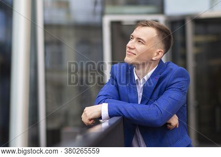 Successful Thoughtful Businessman Standing Outdoors Business Center, Imagining. Young Positive Man,