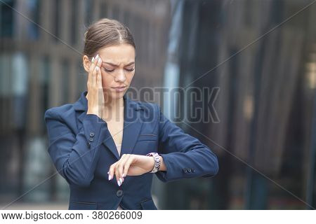 Beautiful Tired Exhausted Businesswoman In Hurry Looking At Her Wrist Watch, Woman Checking Time On