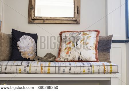 Cushioned Bench In A Home With Decorative Pillows On It