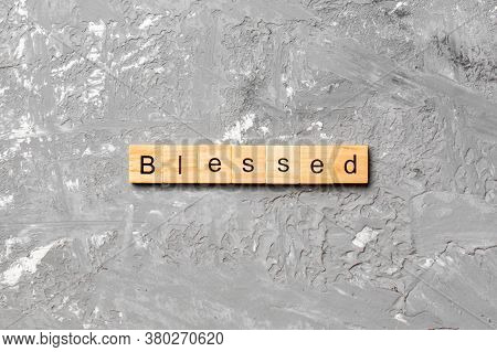 Blessed Word Written On Wood Block. Blessed Text On Table, Concept
