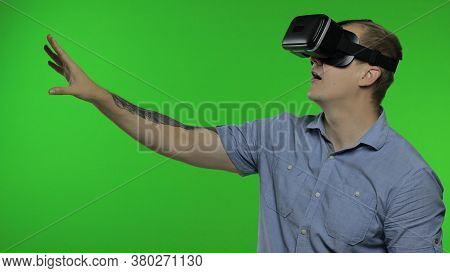 Man Using Vr Technology App Headset Helmet To Play Simulation Game, Drawing. Watching Virtual Realit