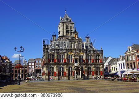 Delft, The Netherlands - August 5, 2020: The City Hall Of The Dutch City Of Delft Against A Clear Bl
