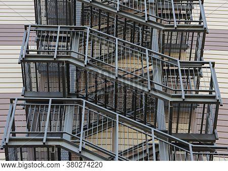 External Metal Fire Escapes Of A Modern Building, External Modern Metal Ladder
