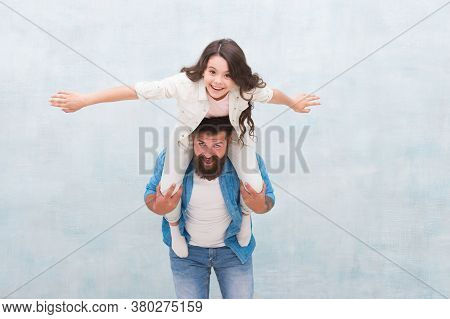 I Believe I Can Fly. Happy Father Piggyback Little Daughter. Bearded Man And Small Child Play Togeth