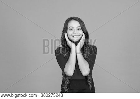 Beauty Is All About Her. Beauty Look Of Little Child. Happy Kid Smile Brown Background. Small Girl W