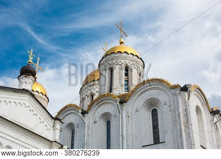 Assumption Cathedral In Vladimir. Ancient Russian Orthodox Church From White Limestone With Golden D