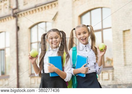 Students Girls Classmates With Backpacks Having School Lunch, Fresh Vitamins Concept.