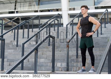 Sport And Fitness Outdoors. Guy Wearing Sports Tracker Wristband Arm. Male Jogging Smart Watch Outsi