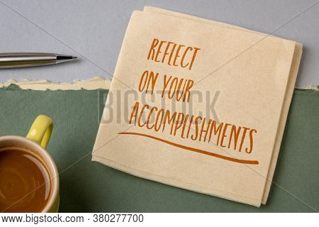 reflect on your accomplishments inspirational note - handwriting on a napkin with a cup of coffee, success and reflection concept