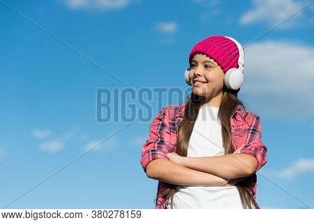 Learn To Listen And Listen To Learn. Happy Girl Listen To Music On Blue Sky. Small Kid Wear Headphon