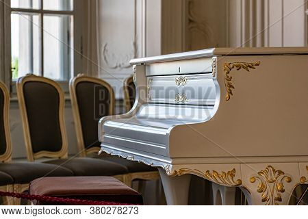White Vintage Grand Piano In The Old Living Room. Vintage Interior.