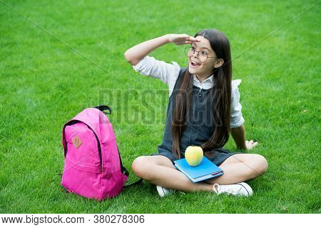 Food For Sight. Happy Child Look Into Distance On Green Grass. School Snack. Vision Care And Eye Che