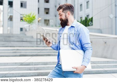 Got Sms. Bearded Man Read Sms In Mobile Phone. Hipster Carry Laptop And Smartphone. Sms Message. Mob