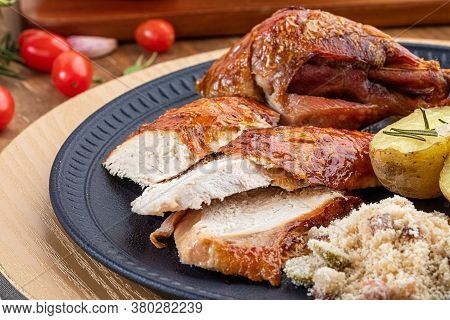 Roasted Turkey Served On A Plate With Farofa, Crumbs And Boiled Potatoes. Thanksgiving Day And Chris