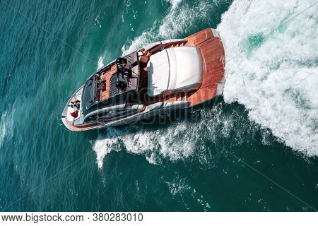 Luxury Yacht, Aerial View Shipyard. Super Yacht Approaching A Tropical Island. Aerial Drone Top Down