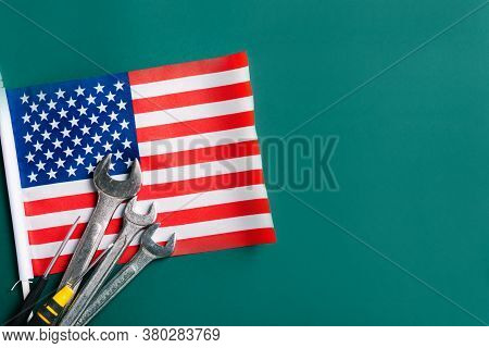 Labor Day Concept, Different Kinds Wrenches With American Flag On Dark Green. First Monday In Septem