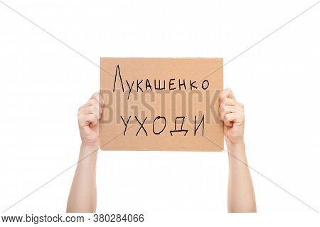 Protest Poster In Hands With Text Lukashenka Go Away, Protester's Hands With Cardboard In Hands Isol