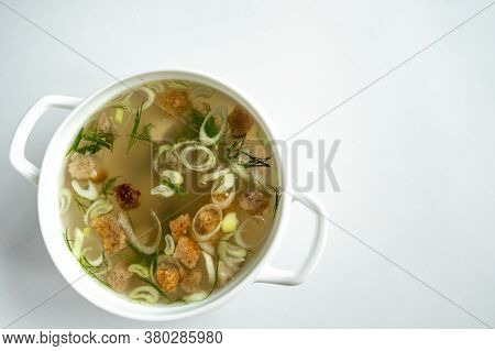 Homemade Meat Broth In A Tureen With Dill, Onions And Croutons. On A White Background. Healthy Food