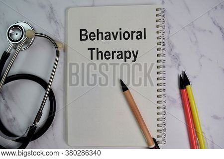 Book About Behavioral Therapy Isolated On Wooden Table.