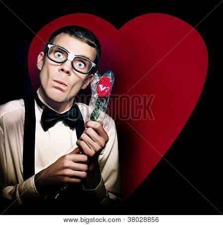 Romantic Nerd Holding Rose On Love Heart Background