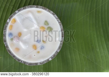 Top View Of Rice Balls With Young Coconut In Sweet Coconut Milk In A Cup On A Banana Leaf Background