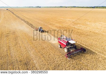 Agriculture Machine Harvesting Crop In Fields. Tractor Pulls A Mechanism For Haymaking. Harvesting I