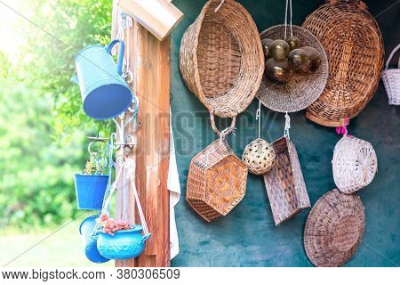 Second-hand Blue Saucepans, Small Bucket , Jug And Old Straw Baskets Turn Into Garden Flower Pots. R