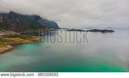 Sea Landscape With Yacht Boat And Stone Islets Among The Waters Of Fjord Vjestfjord, Lofoten Islands